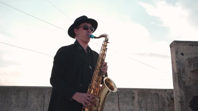 magic sound of saxophone and sunset is what you need for a calm mind - saxophone stock videos & royalty-free footage