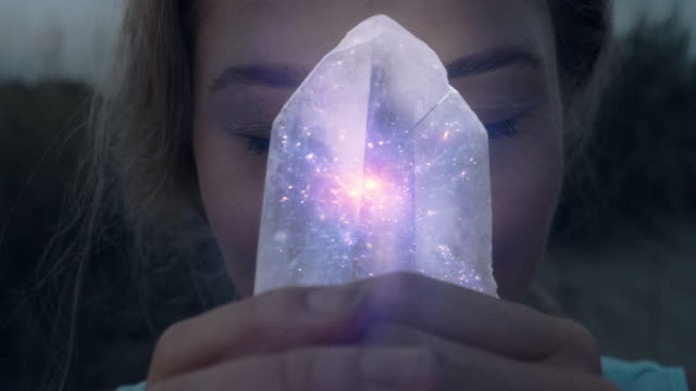 magical galaxy inside crystal. beach meditation - paranormal stock videos & royalty-free footage