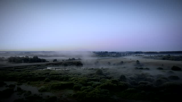 magical misty early morning landscape with groves and fields after sunrise, - atmosphere filter stock videos & royalty-free footage