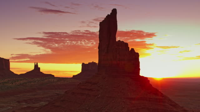 aerial magical monument valley at sunrise - sandstone stock videos & royalty-free footage