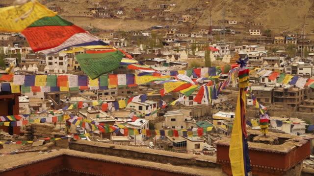 magical prayer flags of leh town, ladakh. - religious equipment stock-videos und b-roll-filmmaterial