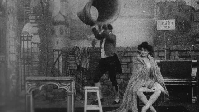 1899 b/w magician and dancer disappearing and reappearing - abwesenheit stock-videos und b-roll-filmmaterial