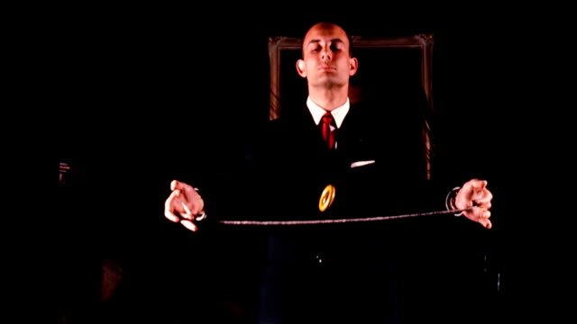 / magician dick zimmerman performs ring trick for crowd man breathes fire / magic castle ext at night magician performs at the magic castle on... - magic trick stock videos & royalty-free footage