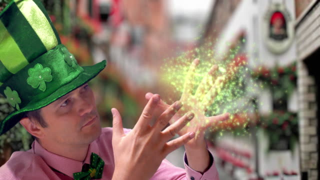 magician in green hat showing magic tricks on st's patrick day - comedian stock videos & royalty-free footage