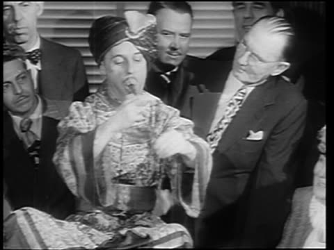 b/w 1946 magician in turban + costume pulling handkerchiefs + egg out of mouth - magic trick stock videos & royalty-free footage