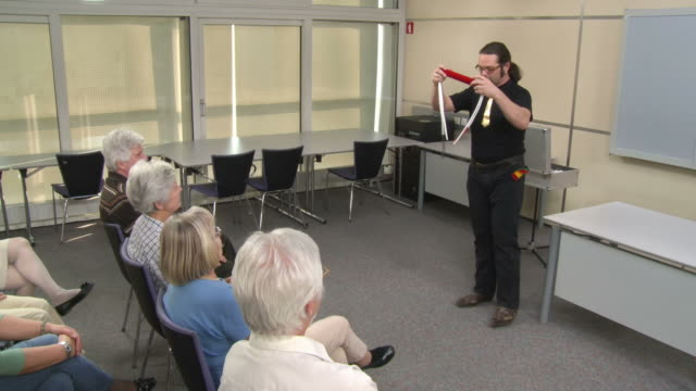 hd: magician performing trick with rope - community centre stock videos & royalty-free footage