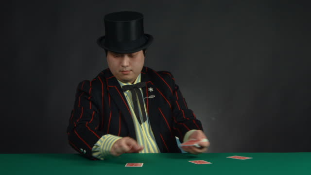 a magician playing with a deck of cards - casino people stock videos & royalty-free footage