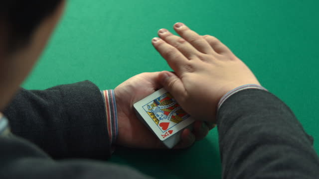 A magician playing with a deck of cards
