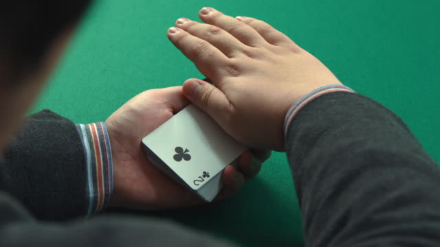 a magician playing with a deck of cards - magic trick stock videos & royalty-free footage
