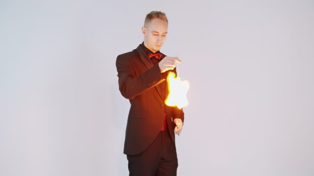 magician showing a magic trick - magic trick stock videos and b-roll footage