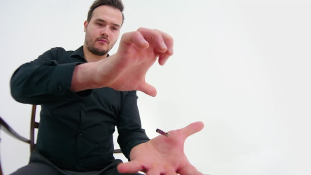 magician showing a magic trick - magic trick stock videos & royalty-free footage