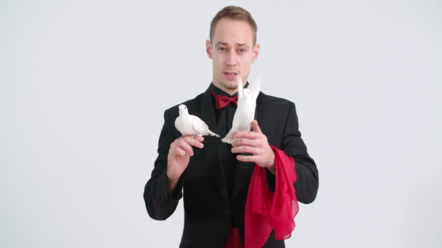 Magician with doves