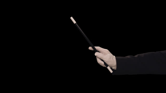 ms magician's hand waves wand � vertical - magician stock videos & royalty-free footage
