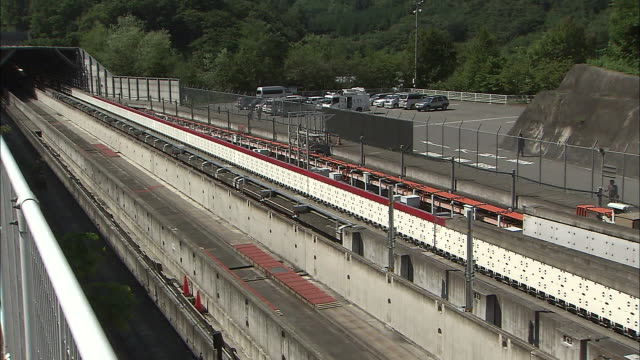 vidéos et rushes de a maglev train speeds out of a tunnel on a trial run - préfecture de yamanashi