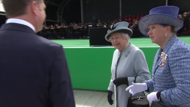 Queen attends ceremony Queen Elizabeth II along to unveil plaque marking 800th anniversary of the Magna Carta as orchestra plays SOT / Queen shaking...