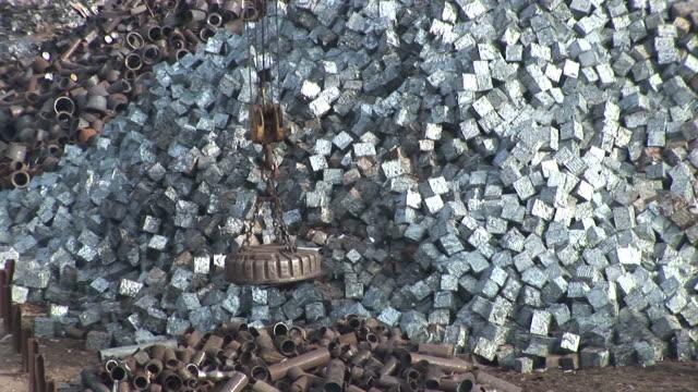 ms td magnet being lifted steel scrap at scrapyard / bous, saarland, germany - junkyard stock videos and b-roll footage