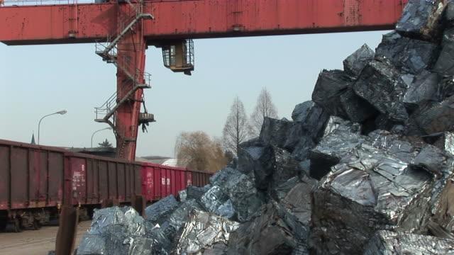 ws magnet crane lifting steel  craps at scrapyard / bous, saarland, germany - craps stock videos & royalty-free footage
