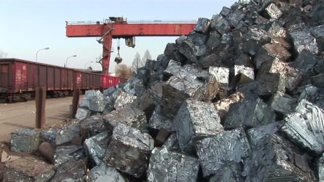 ws pan  magnet crane lifting steel  craps at scrapyard / bous, saarland, germany - craps stock videos & royalty-free footage