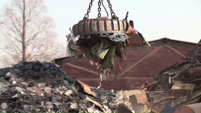 MS POV Magnet lifting steel scrap at scrapyard / Bous, Saarland, Germany