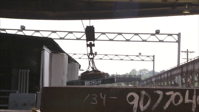 a magnetic crane operates at a steel mill. - hoisting stock videos & royalty-free footage