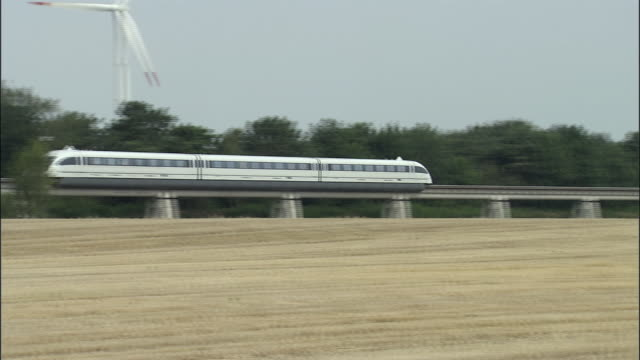 ws, ts, magnetic levitation train (maglev) train gliding through fields, germany - 2006 stock videos & royalty-free footage