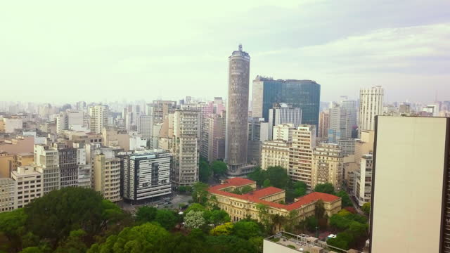 magnificent aerial view of downtown são paulo and its historic buildings at dawn on a cloudy day - são paulo stock videos & royalty-free footage
