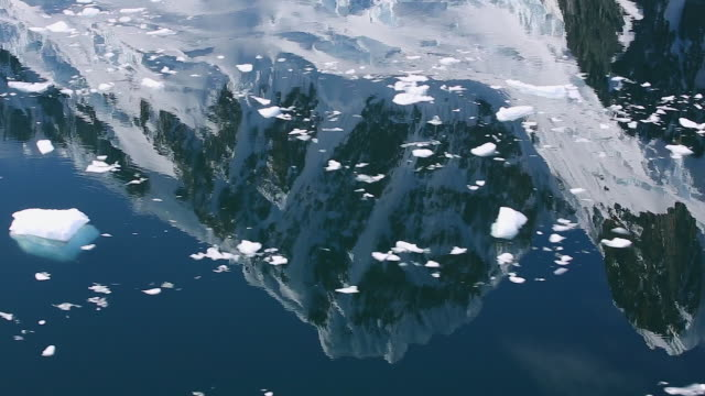 magnificent reflections of glaciers and mountains with brash ice on water - ice floe stock videos & royalty-free footage