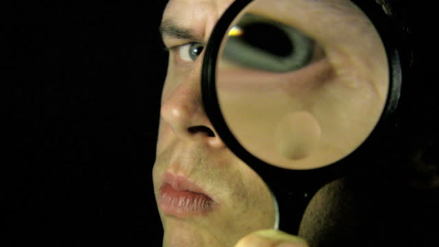 magnifying eye (hd) - detective stock videos & royalty-free footage