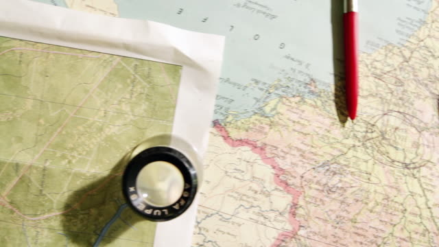 CU PAN Magnifying glass and pen on map / Philadelphia, Pennsylvania, United States