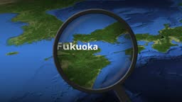 Magnifying glass finds Fukuoka city on the map, 3d rendering