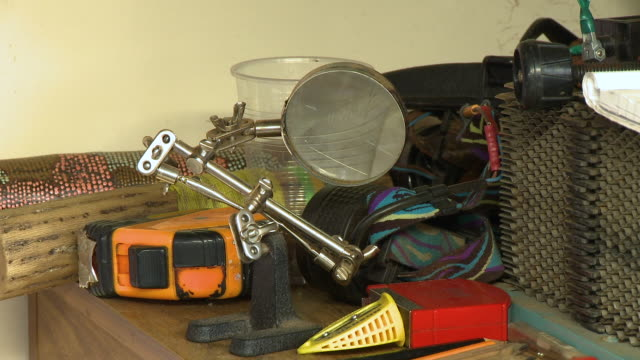 magnifying glass with clamps on a desk - clamp stock videos & royalty-free footage