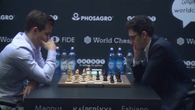 magnus carlsen and fabiano caruana begin the final day of the 2018 world chess championship with the norwegian and us players tied after 12 games - world championship stock videos and b-roll footage