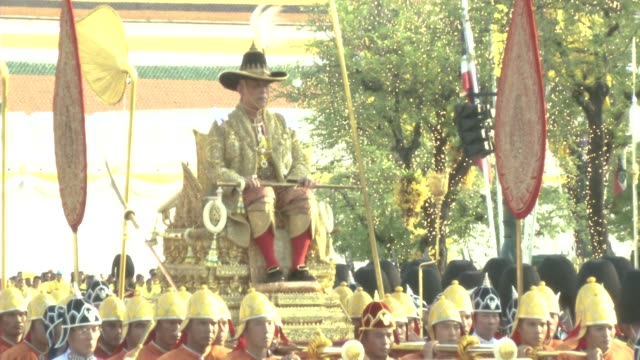 maha vajiralongkorn bodindradebayavarangkun the new king of thailand is carried during a procession outside the grand palace in bangkok - coronation stock videos and b-roll footage