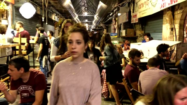 mahane yehuda shuk on a weekday night is open for beer and young jerusalemites. - weekday stock videos & royalty-free footage