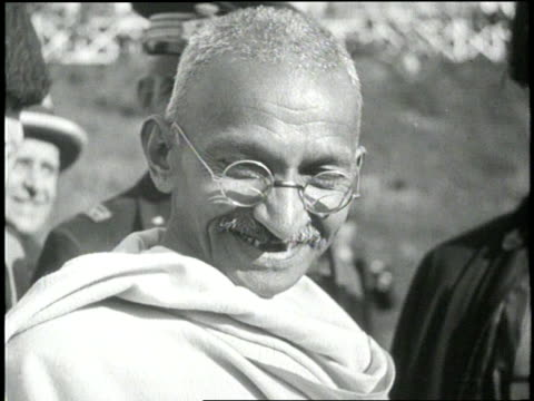 stockvideo's en b-roll-footage met mahatma gandhi smiles as he works to unite his people. - mahatma gandhi
