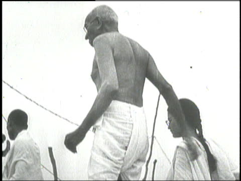 stockvideo's en b-roll-footage met mahatma gandhi stands with his hands in prayer position. - mahatma gandhi