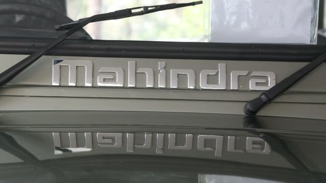 a mahindra mahindra ltd badge is displayed below the windshield of a thar sports utility vehicle on display at a nbs international ltd dealership in... - badge stock videos & royalty-free footage