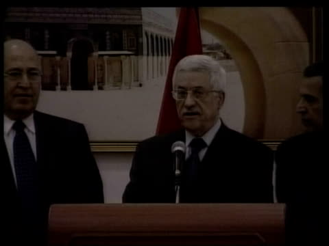 mahmoud abbas and ariel sharon agree to meet date mahmoud abbas at press conference ariel sharon at meeting and then press conference - ariel sharon stock videos and b-roll footage
