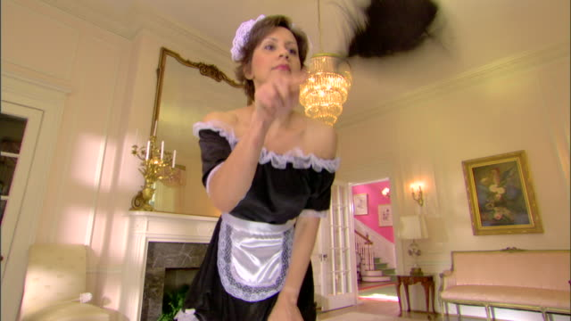 Maid cleaning with feather duster