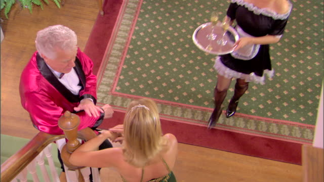 maid serving champagne to couple - domestic staff stock videos & royalty-free footage