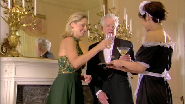 maid serving drinks to couple - see other clips from this shoot 1277 stock videos and b-roll footage
