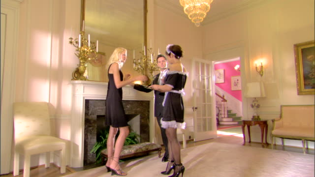 maid serving drinks to couple - wealth stock videos & royalty-free footage