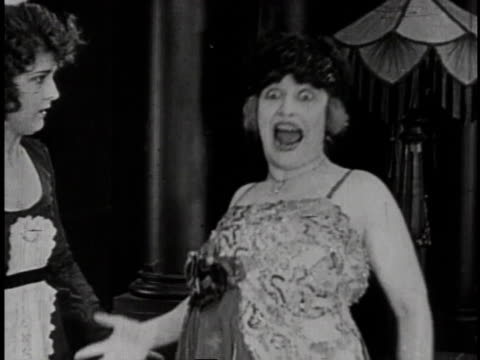 1920 montage maid trying to help woman panicking after lizard crawls down the back of her dress - larry semon stock videos and b-roll footage