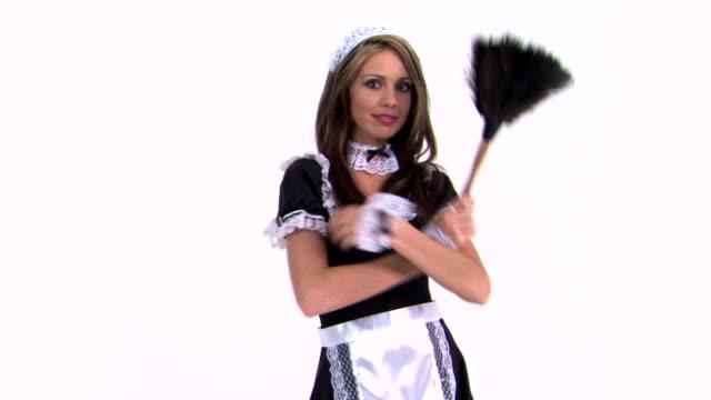 vídeos de stock, filmes e b-roll de maid with arms crossed holding feather duster - pano de pó