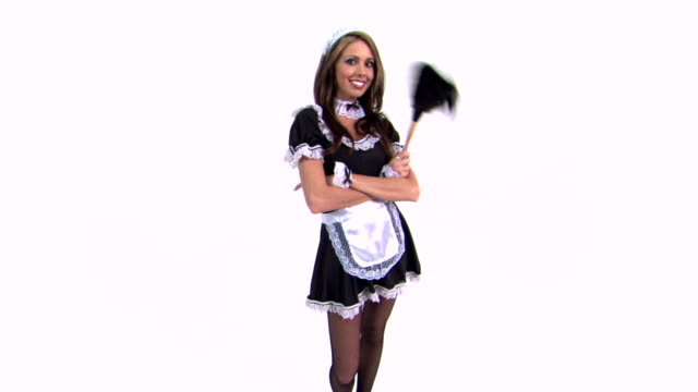 Maid with arms crossed holding feather duster