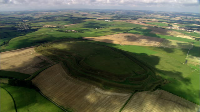 maiden castle  - aerial view - england, dorset, west dorset district, united kingdom - battle stock videos & royalty-free footage