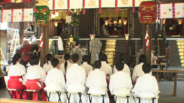 maidens of the kushida shrine stand at attention while elders dedicate a harvest of ginkgo nuts to the god of the shrine. - fukuoka prefecture stock videos & royalty-free footage