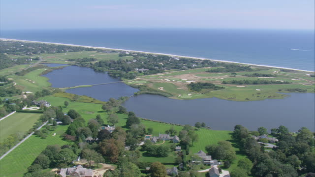 aerial maidstone golf club and surrounding properties along the sandy coastline / east hampton, new york, united states - long island video stock e b–roll