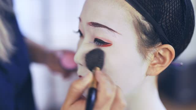 maiko (geisha in training) getting special white makeup - social grace stock videos & royalty-free footage