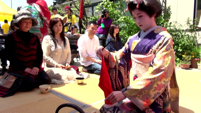 maiko traditional japanese dancers clad in kimonos on saturday may 23 welcomed participants by serving cups of green tea at a tea ceremony held as a... - ceremony stock videos & royalty-free footage